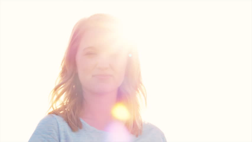 Close up portrait of pretty young blonde girl smiling, turns and looks up at the sky | Shutterstock HD Video #14083202