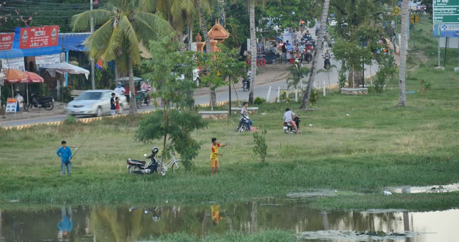 SIEM REAP, CAMBODIA - NOVEMBER 2015: Life on the streets in Siem Reap Cambodia. Popular tourist travel destination. - 4K stock video clip
