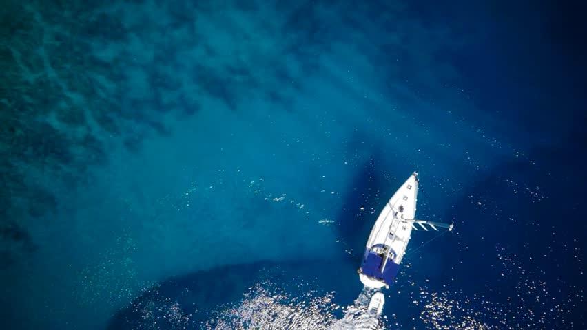 Yacht in amazing clear sea / ocean - water - taken from top by drone  | Shutterstock HD Video #14099933