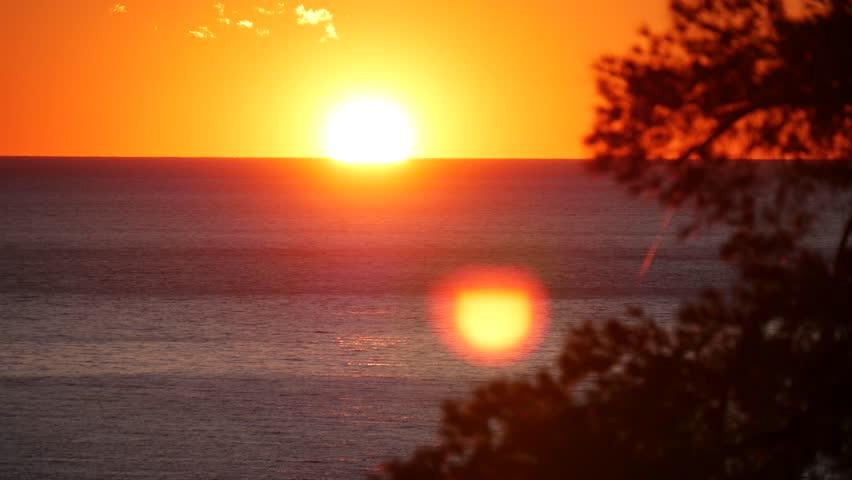 PORTOFINO, ITALY - CIRCA DECEMBER 2015: the beautiful orange light of the setting sun on the sea of Liguria. | Shutterstock HD Video #14144114