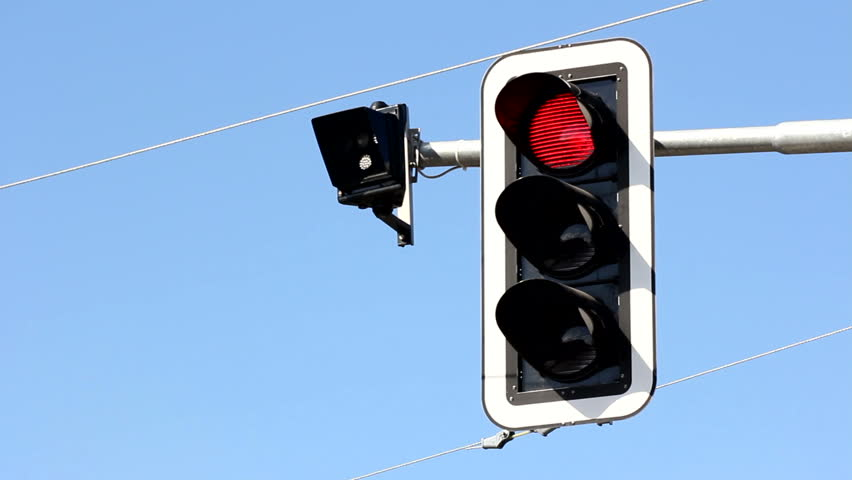 Hanging traffic light regulates cars and trams traffic