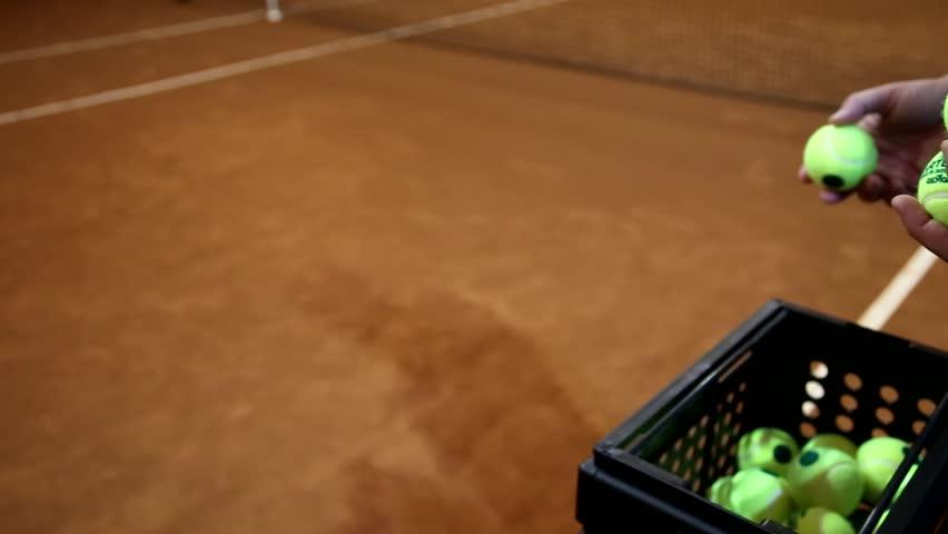Tennis balls in hands - HD stock footage clip