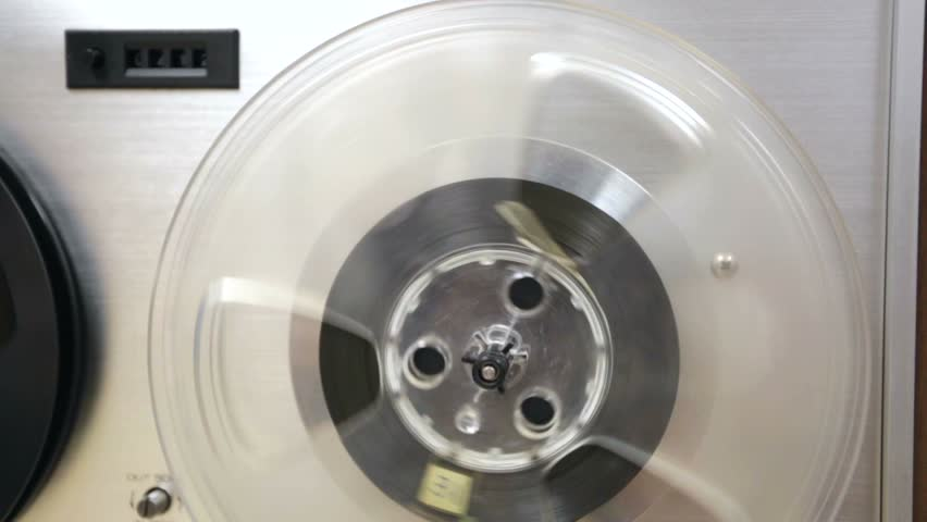 Closeup view of an old portable reel to reel tube tape-recorder.   Shutterstock HD Video #14194793