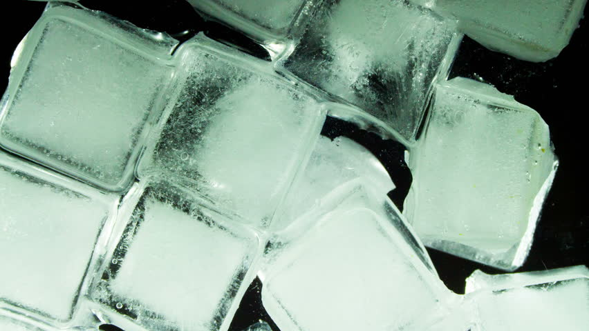 Ice Cube Melting and Moving on a Glass Surface | Shutterstock HD Video #14221955