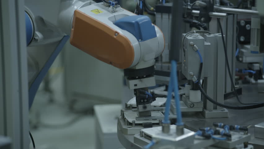 Industrial robot arm in factory, close. | Shutterstock HD Video #14240342