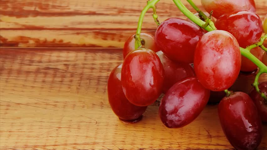 fresh raw red grape on wooden table 1920x1080 intro motion slow hidef hd
