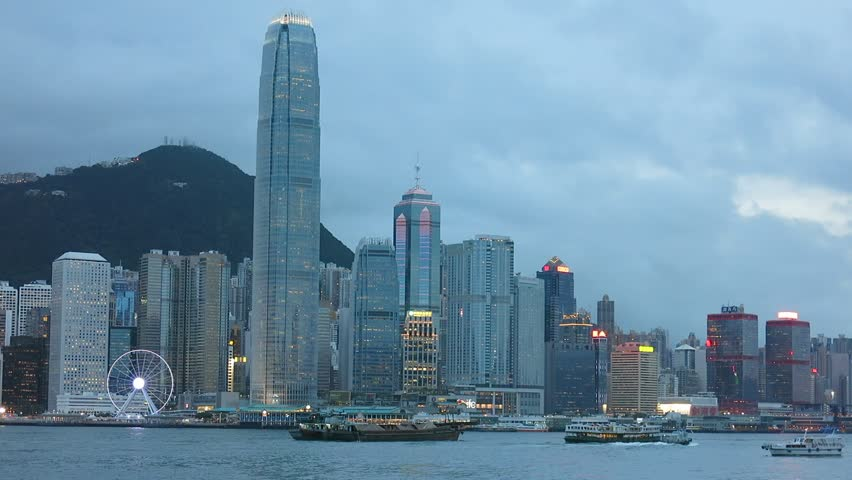 Hong Kong, China – August 13, 2015: Skyscrapers at Victoria Harbour of Hong Kong. Boats are in the harbour.