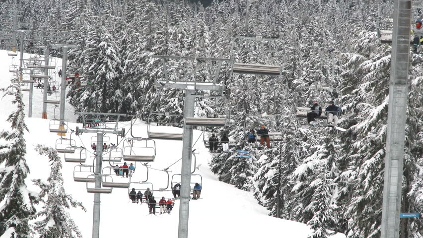 MT HOOD, OREGON - CIRCA 2016: Busy day at Mt Hood, Timberline in Oregon with people riding ski lift after fresh snow came down the night before.