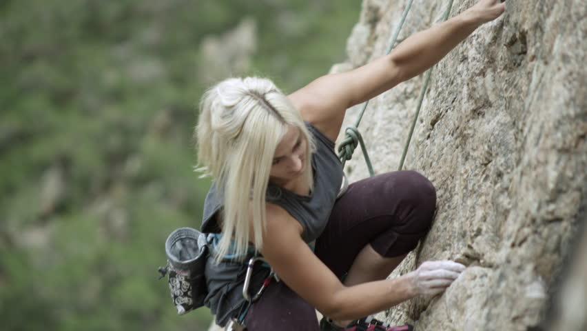 Woman rock climbing and topping out. | Shutterstock HD Video #14275100