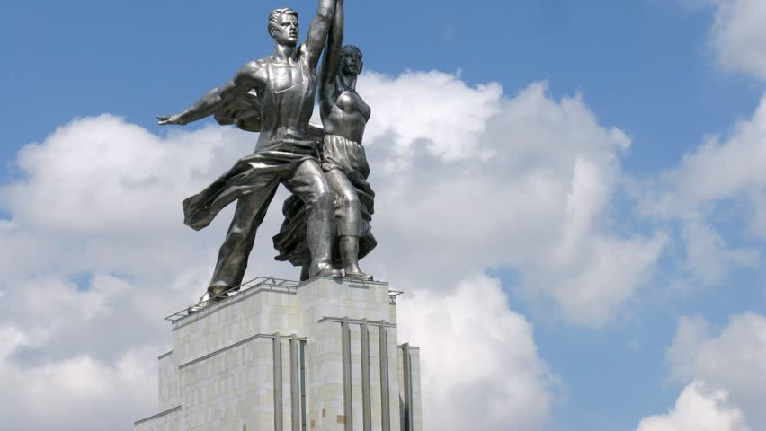 Worker and Kolkhoz Woman in front of passing clouds, side view, time lapse - HD stock footage clip