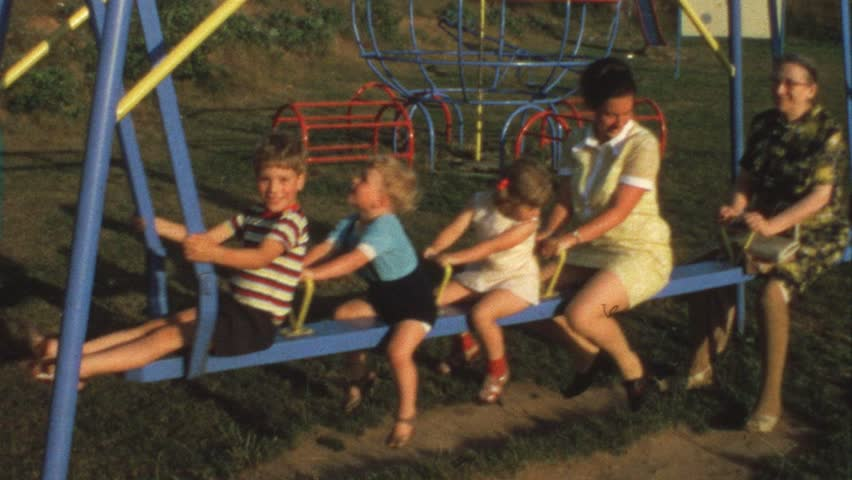 Mother, grandma and children on swing (vintage 8 mm film)