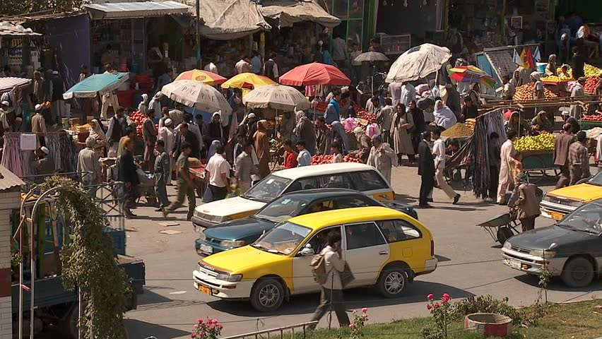 Taxis and vehicle traffic near a busy fruit market in Kabul, Afghanistan. - SD stock video clip