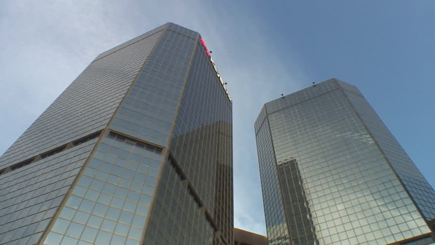 Multiple short tracking shots of modern office buildings; low angle, street to sky, Denver Colorado - HD stock footage clip