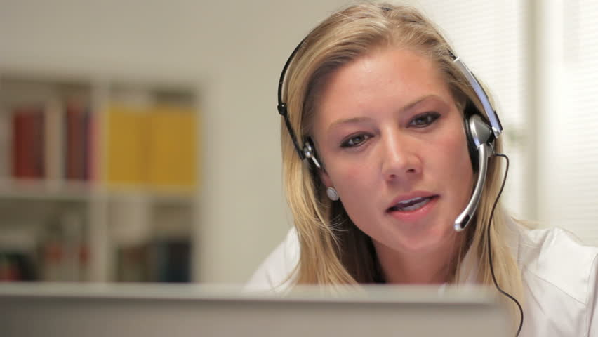 Female telephone customer service operator, happy