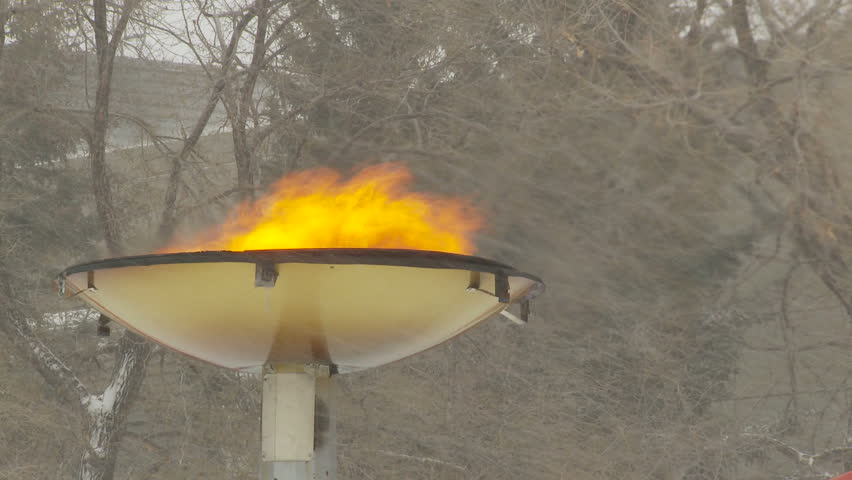 Olympic flame in snow storm