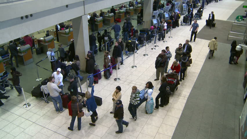 CALGARY, CANADA - CIRCA 2008: Airport travelers wait for flights during the busy Christmas rush, circa 2008 in Calgary.
