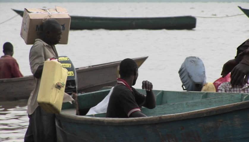 LAKE VICTORIA, UGANDA - CIRCA 2009: Fisherman loads boat circa 2005 along Lake Victoria. - HD stock video clip