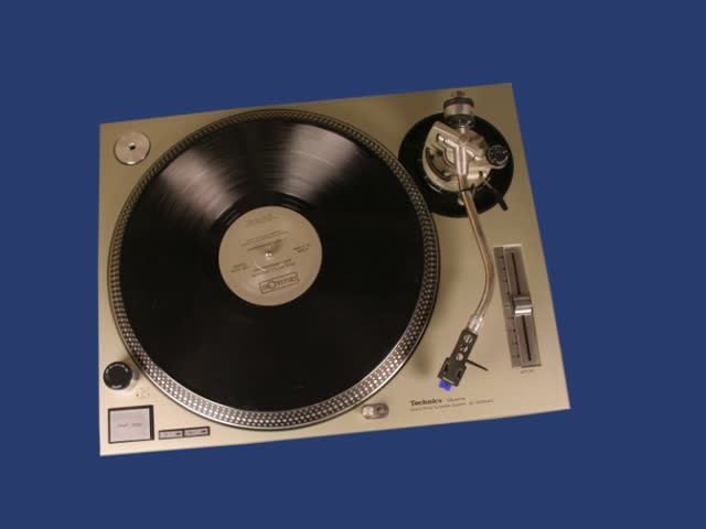 hand scratching a moving record turntable - SD stock video clip