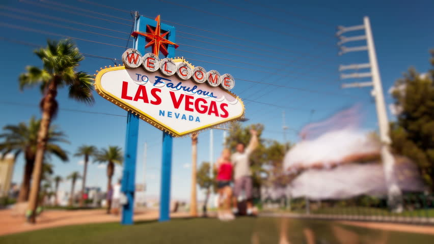 Timelapse of people taking photographs in front of the Welcome to Las Vegas sign