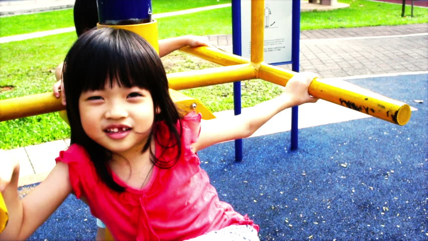 Asian Sibling, brother and sister playing at the playground - HD stock video clip