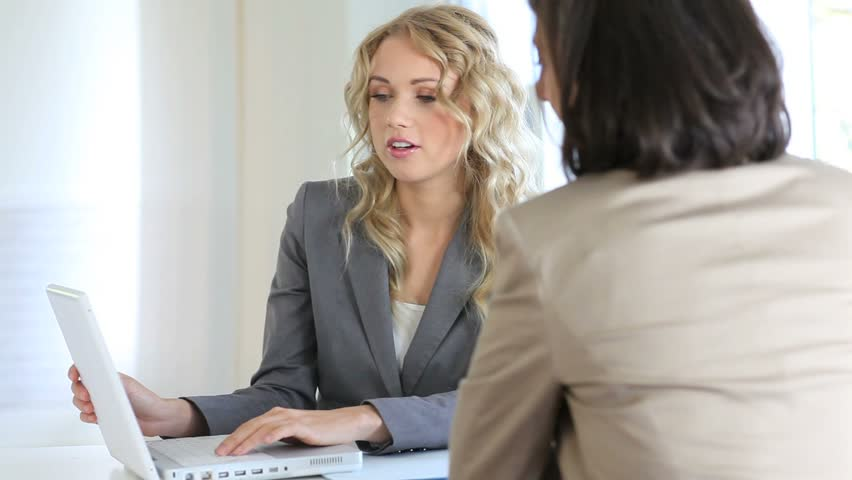 Real-estate agent with client in office