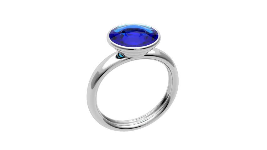 Presentation of platinum ring with blue diamond - HD stock video clip