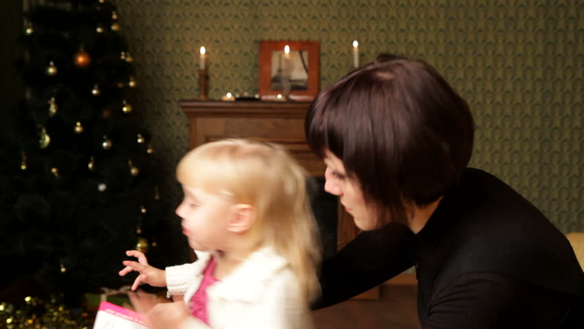 New Years gift. Mom allows her daughter to choose a few for Christmas gifts. Two frames. - HD stock footage clip