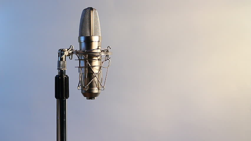 A Closeup View Of A Mic Cord Being Attached To A Condenser