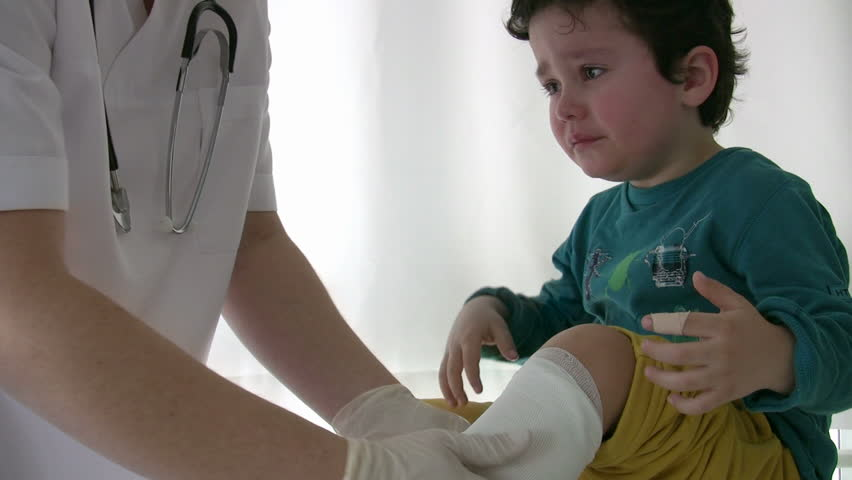 Doctor bandage on child leg - HD stock video clip