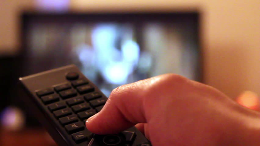 Watching TV-changing channels, blurred TV  - HD stock footage clip