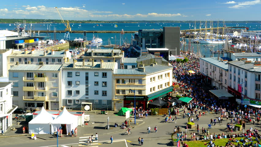 Brest, France - July 14, 2016: Cinemagraph on the Brest International Maritime Festival in summer 2016 - Timelapse above the crowd - old rigging and sailing ships.