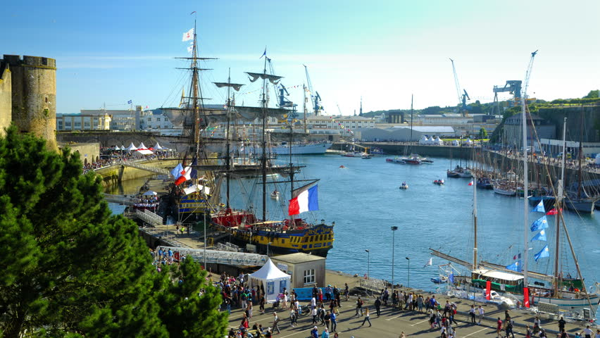 Brest, France - July 14, 2016: Old riggings under the castle of Brest in the Penfeld river during the Maritime Festival. Ships Hermione and Cuauhtemoc in timelapse in the old military harbor.