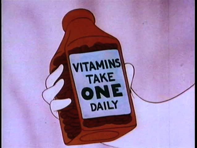 Close-up  hand holding vitamin bottle