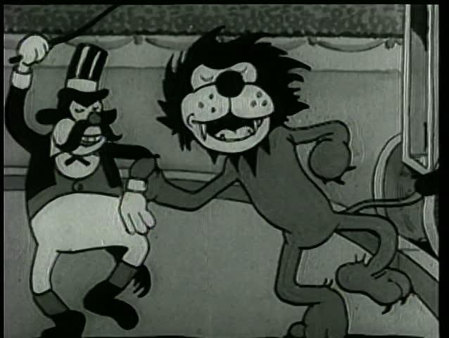 Lion and lion tamer dancing at circus