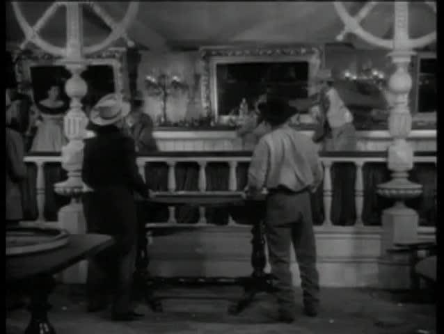 Wide shot of western bar room brawl