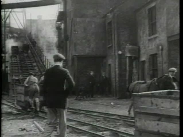 Rear view of men working in coal mine