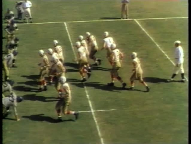 College football players setting up play