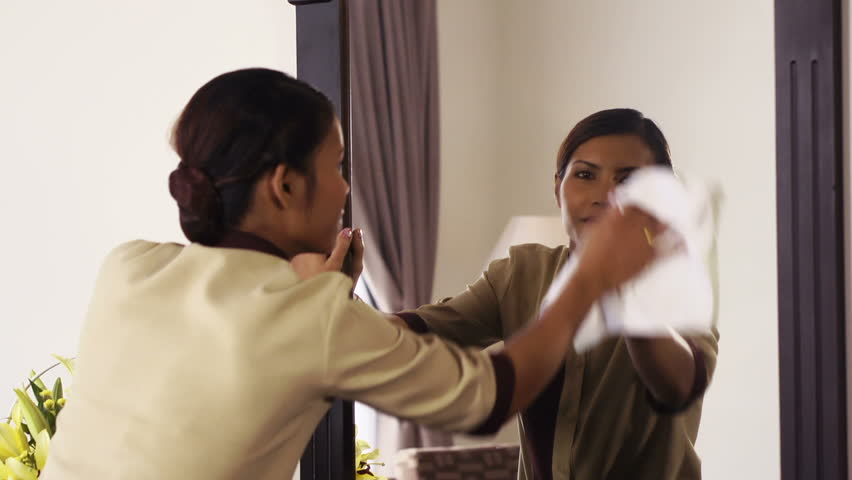 Portrait of happy Asian housekeeper at work in luxury resort room as maid and smiling at camera, housemaid working in hotel - HD stock video clip