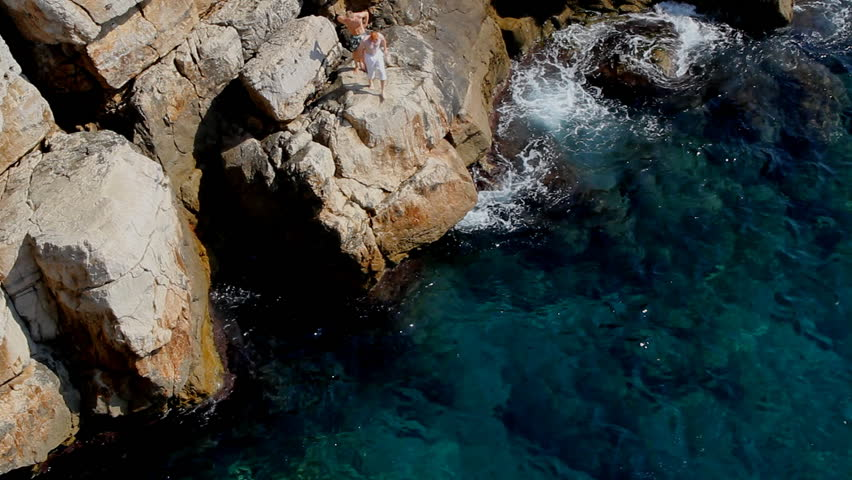 Man jumps from cliff of Dubrovnik into Adriatic water, Croatia