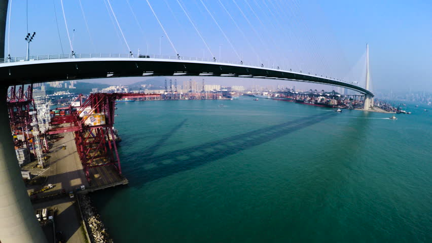 Hong Kong Container Port. Hong Kong 4K Aerial Top View. 4K aerial upward shot of the Kwai Chung terminal with traffic on bridge. Container vessels on sea and crane loading activities in terminal.  | Shutterstock HD Video #18811802