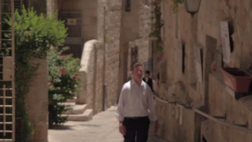 IZRAEL, JERUSALEM - 7 JUNE 2016: Woman tourist walking on the streets of Jerusalem in Israel   Shutterstock HD Video #18897437