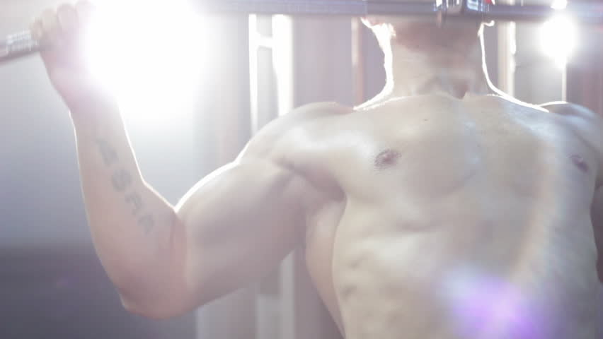 bodybuilder exercising pectoral at gym  - HD stock video clip