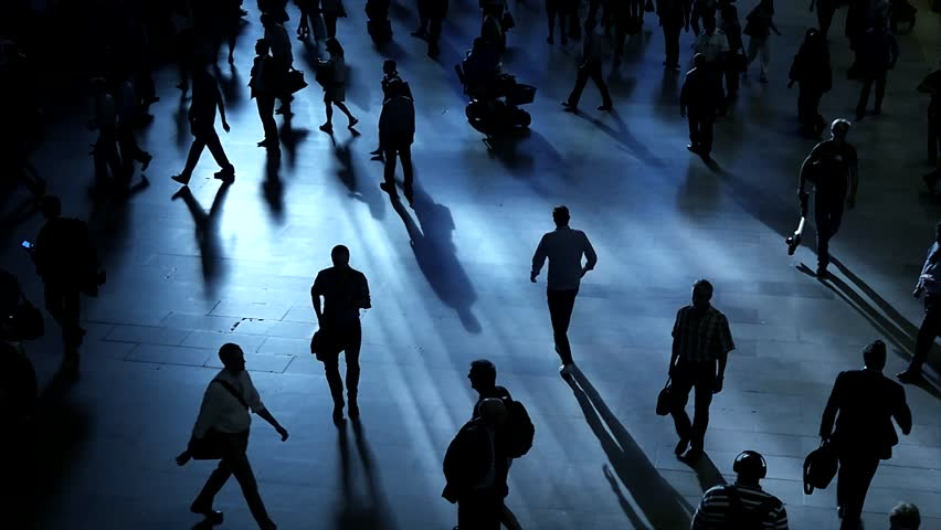 Unrecognizable crowd of business people commuting to work. pedestrians walking on crowded city street | Shutterstock HD Video #18919064