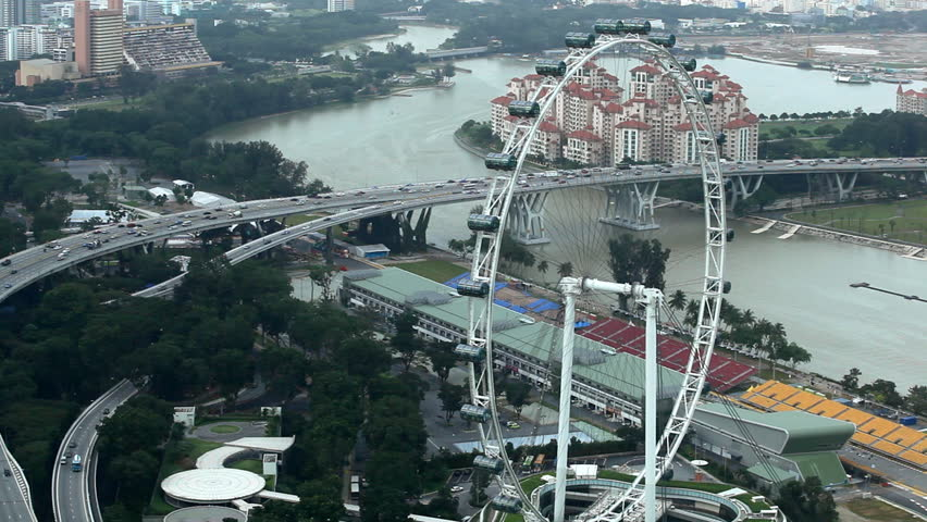 "Aerial View of East Coast PKWY Highway big traffic ""Rush Hour"" near Formula 1 Circuit and Singapore Flyer - HD stock footage clip"
