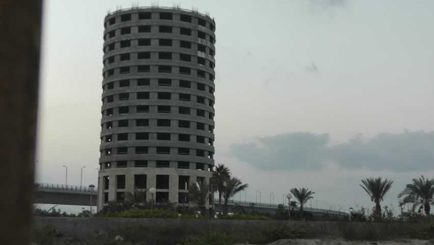The leaning building in Acre (Akko), Israel is imploded after the bankrupt builder was required by court to demolish the 15 story building. The building was built illegally and was sinking in the sand