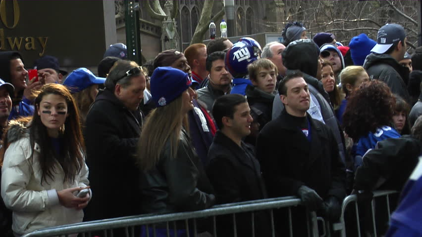 NEW YORK - FEBRUARY 7: Fans wait in anticipation of the ticker-tape parade in honor of the Super Bowl XLVI Champions New York Giants on Tuesday, February 7th, 2012 in New York.  - HD stock video clip