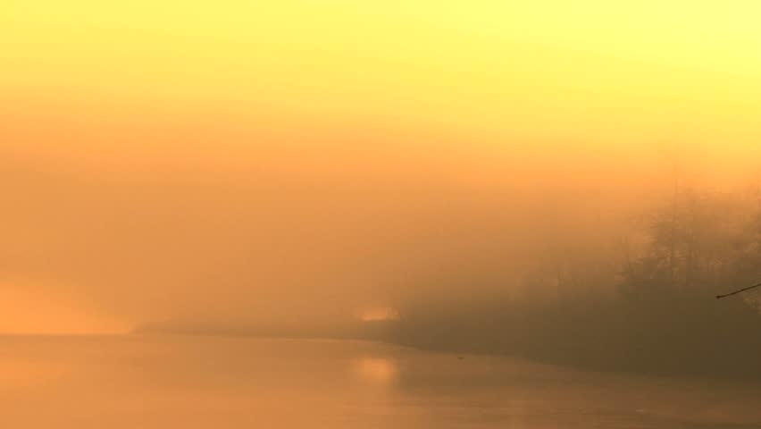 Mystic golden misty riverscape pan right to left - HD stock video clip
