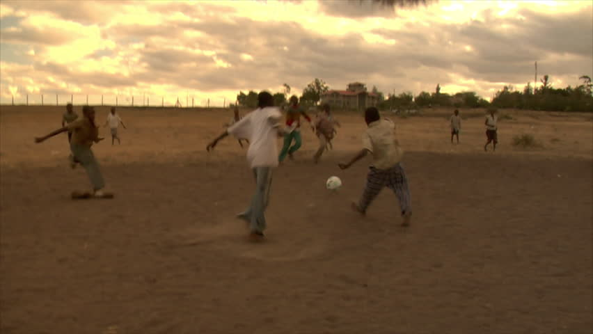 KENYA - CIRCA 2006: Group of unidentified boys run and play soccer circa 2006 in Kenya.