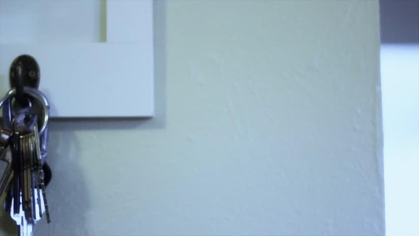Keys hanging on a key rack (dolly shot) | Shutterstock HD Video #2038286