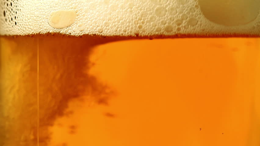 Beer is poured in a glass.  - HD stock footage clip